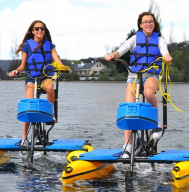 two young women on hydrobikes